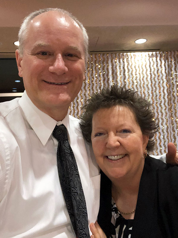 Scott and Susie Huelsman of The Susie Show attending a black-tie event