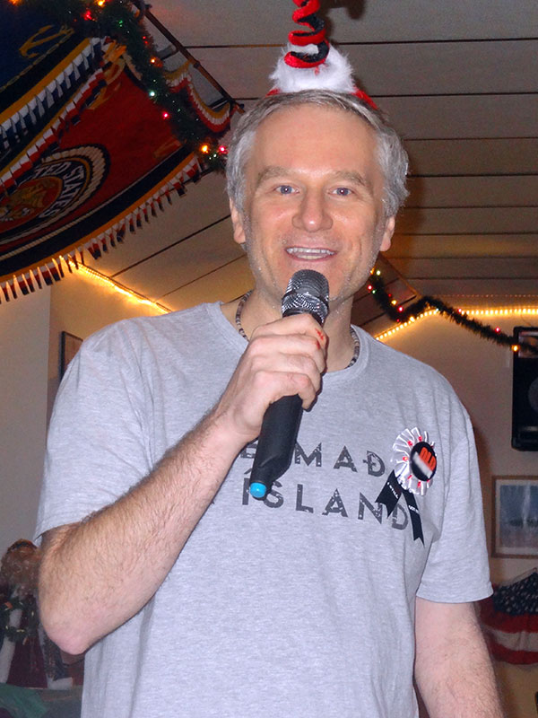 A guy singing at a Christmas karaoke show hosted by The Susie Show