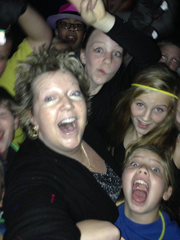 Susie Huelsman of The Susie Show enjoying a party at a school dance