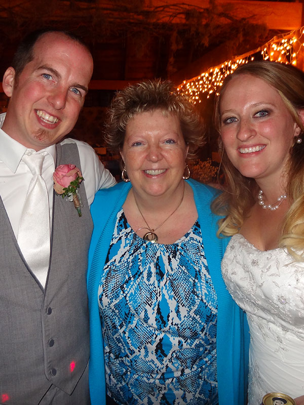 Susie Huelsman standing with another bride and groom
