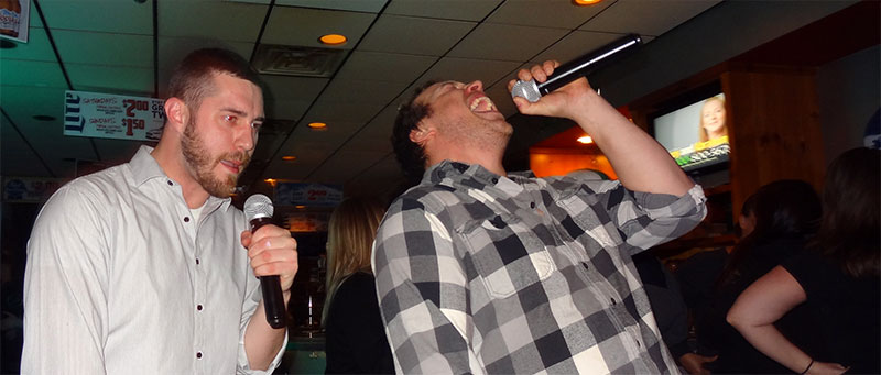 Two men enjoying karaoke hosted by The Susie Show