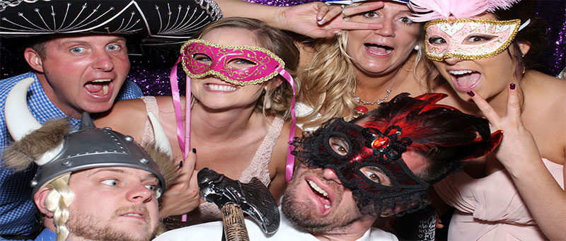 Six partygoers enjoying The Susie Show photo booth!