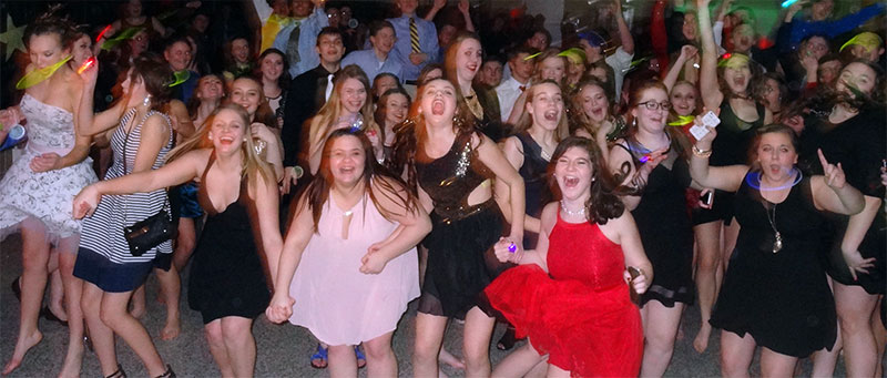 Dozens and dozens of teenagers enjoy their school dance hosted by The Susie Show